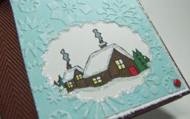 Snowfall_on_winter_house_closeup_by